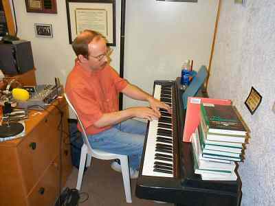 David Denniston at the piano in Anne LeBaron's studio
